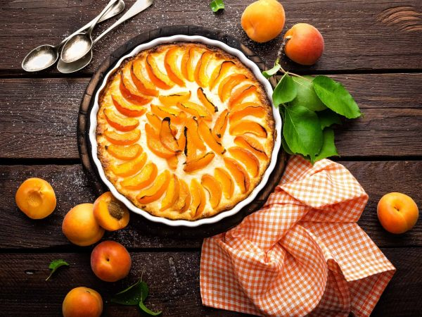 80447375 – apricot cake or pie with fresh fruits, cheesecake