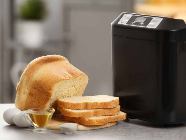 Sliced loaf with bread machine on table
